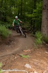 Erik leans his new Intense Slopestyle II into a reworked berm on Bear's